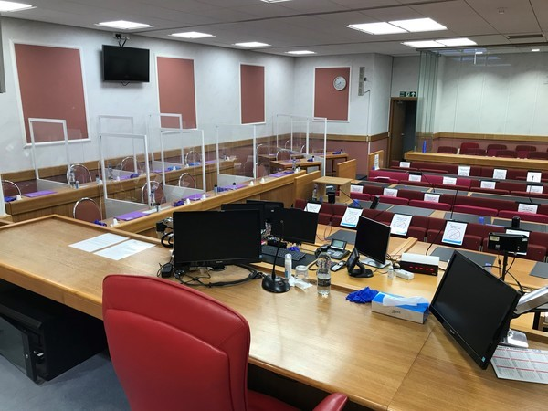The use of plexiglass partitions allows for a 12-person jury to be able to sit in a courtroom, whilst maintaining social distancing. Photo: Designing safe spaces in Leeds Crown Court - Inside HMCTS (blog.gov.uk)